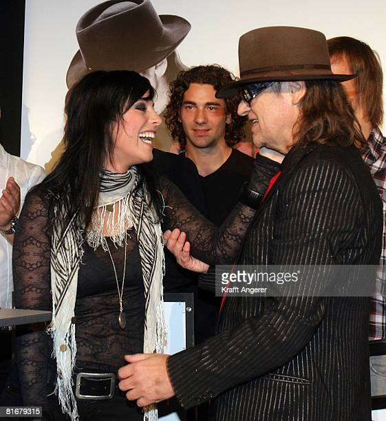 Singer Stefanie Kloss from the band Silbermond and Singer Udo Lindenberg pose during the Platin and TripleGold Award at the 'Bank' on June 23 2008 in...