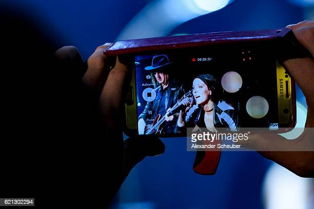 Singer Stefanie Kloss of the band Silbermond is seen on a smartphone display during her performance at the German Sports Media Ball at Alte Oper on...