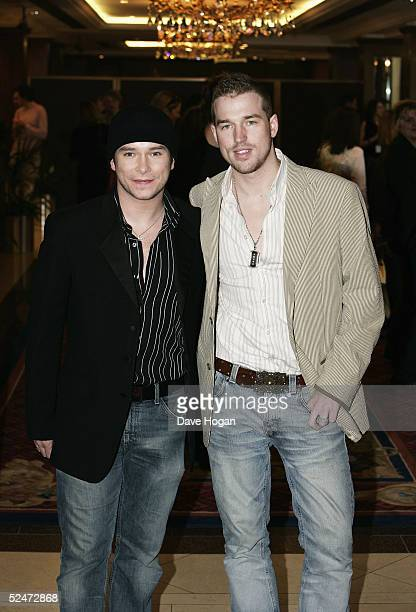 Singer Stephen Gately and his partner Andy Cowles arrive at the Capital FM Awards 2005 at the Royal Lancaster Hotel on March 23 2005 in London The...