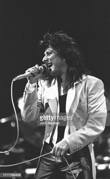 """Singer Steve Perry is shown performing on stage during a """"live"""" concert appearance with Journey on June 1, 1983."""