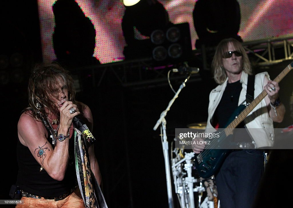 Singer Steven Tyler and bass player Tom Hamilton, from band Aerosmith, perform on June 1, 2010, at La Guacima, 24 kilometers north from San Jose, during their concert in Costa Rica as part of the 'Cocked, Locked, Ready to Rock' tour. AFP PHOTO / Mayela LOPEZ