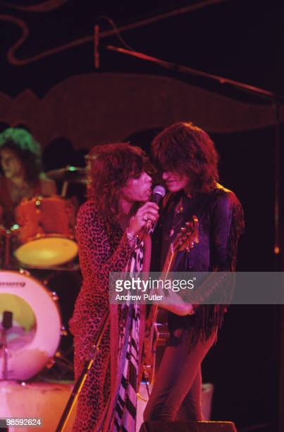 Singer Steven Tyler and guitarist Joe Perry of Aerosmith perform on stage at the Hammersmith Odeon in London, England on October 16, 1976.