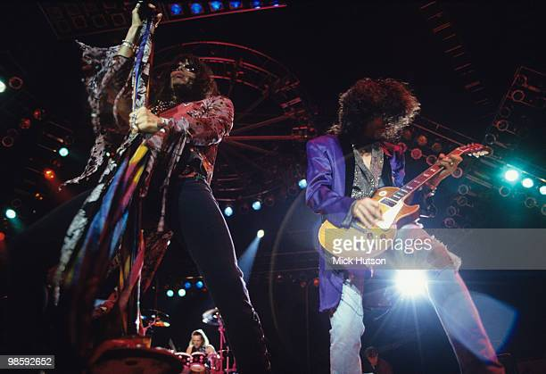 Singer Steven Tyler and guitarist Joe Perry of Aerosmith perform on stage at Wembley Arena in London England in December 07 1993