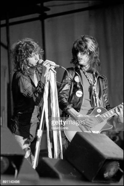 Singer Steven Tyler and guitarist Joe Perry of the rock band 'Aerosmith' perform onstage at Reading Festival in August 1976 in England