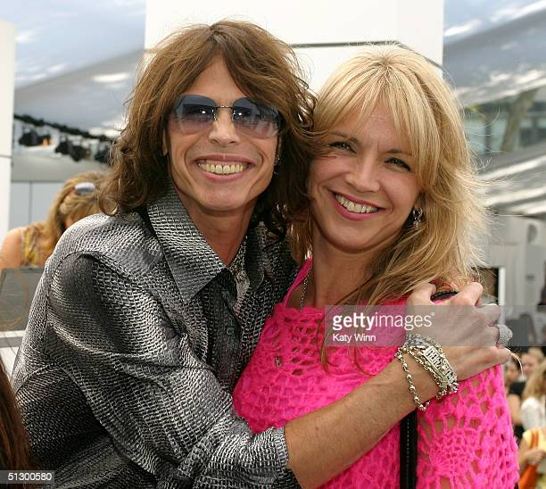 Singer Steven Tyler and wife Teresa Barrick are seen during the Olympus Fashion Week Spring 2005 at Bryant Park September 13 2004 in New York City