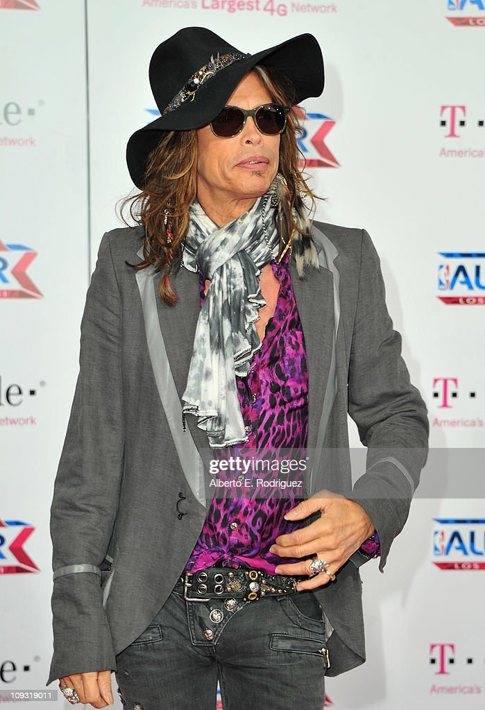 Singer Steven Tyler arrives to the T-Mobile Magenta Carpet at the 2011 NBA All-Star Game on February 20, 2011 in Los Angeles, California.