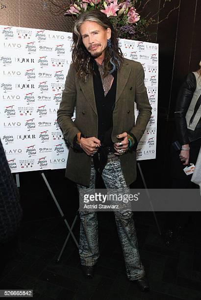 Singer Steven Tyler attends an exclusive event with DuJour's Jason Binn and Nicole Vecchiarelli to celebrate the 'Steven TylerOut On A Limb' charity...