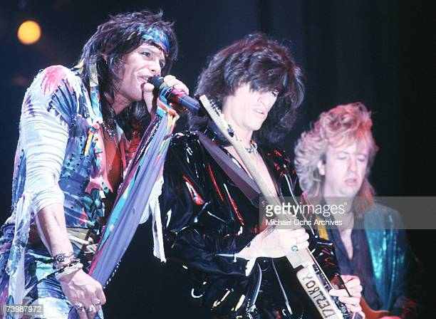 Singer Steven Tyler bassist Tom Hamilton and guitarist Brad Whitford of the Rock and roll band 'Aerosmith' perform onstage in 1987 in Los Angeles...