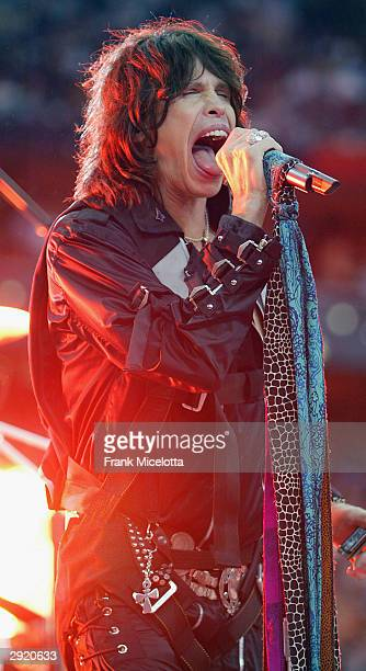 Singer Steven Tyler of Aerosmith performs during the pregame show prior to the start of Super Bowl XXXVIII between the New England Patriots and the...