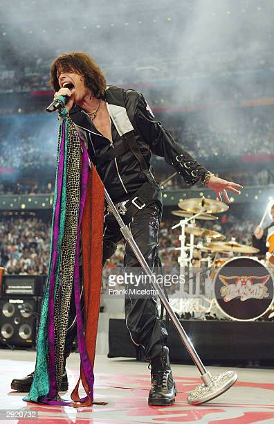 Singer Steven Tyler of Aerosmith performs during the pre-game show prior to the start of Super Bowl XXXVIII between the New England Patriots and the...