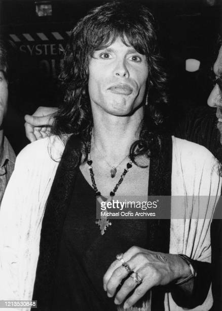 Singer Steven Tyler of American rock band Aerosmith arrives at the MTV Awards at the Universal Amphitheatre, Los Angeles, USA, circa 1987. He...