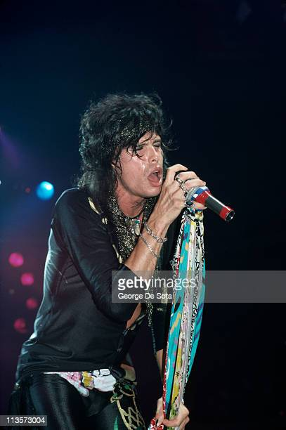 Singer Steven Tyler performing on stage with American rock group Aerosmith 1988