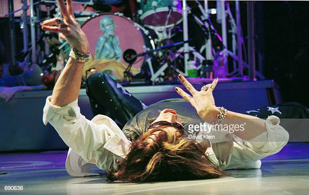 Singer Steven Tyler performs live with his band Aerosmith at The Forum January 13 2002 in Inglewood CA