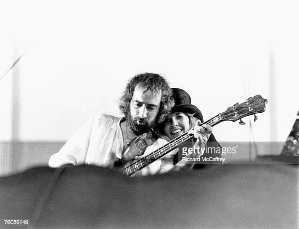 Singer Stevie Nicks and bass player John McVie of the rock group 'Fleetwood Mac' perform onstage in May 1977 in Oakland California