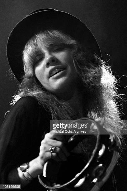 Singer Stevie Nicks of the rock and roll group Fleetwood Mac plays tambourine performs onstage in circa 1978