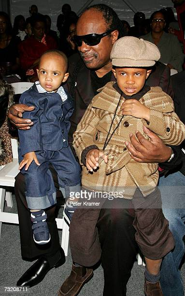 Singer Stevie Wonder and his children pose in the front row at the Kai Milla Fall 2007 fashion show during MercedesBenz Fashion Week in the Salon in...