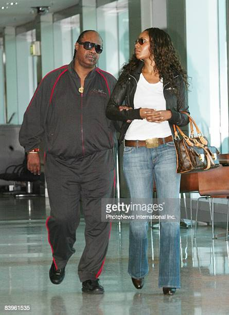 SYDNEY AUSTRALIA OCTOBER 24 Singer Stevie Wonder and his daughter Aisha Morris leave Sydney International Airport destined for Stevie's next concert...