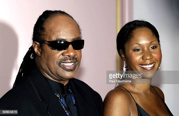 Singer Stevie Wonder and his daughter Aisha Morris pose for photographers before the start of the 29th Annual TJ Martell Foundation Awards Gala at...