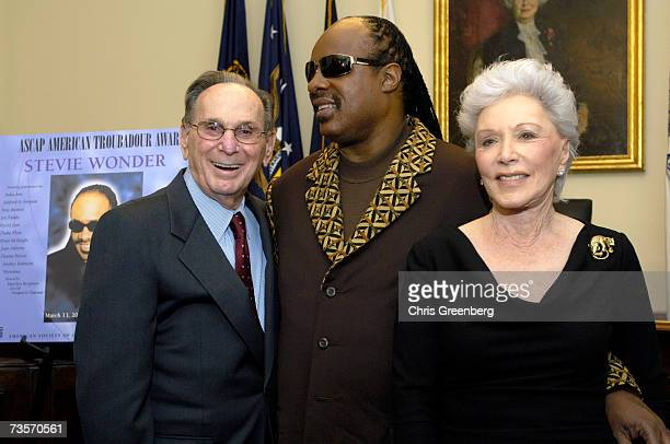 Singer Stevie Wonder poses for a picture with ASCAP Board Member Hal David and his wife Eunice David in the greenroom during the American Society of...