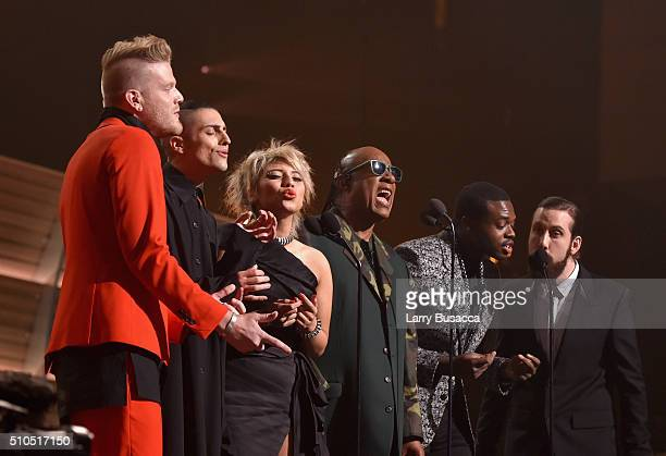 Singer Stevie Wonder with singers Scott Hoying Mitch Grassi Kirstin Maldonado Kevin Olusola and Avi Kaplan of Pentatonix performs a tribute to Earth...