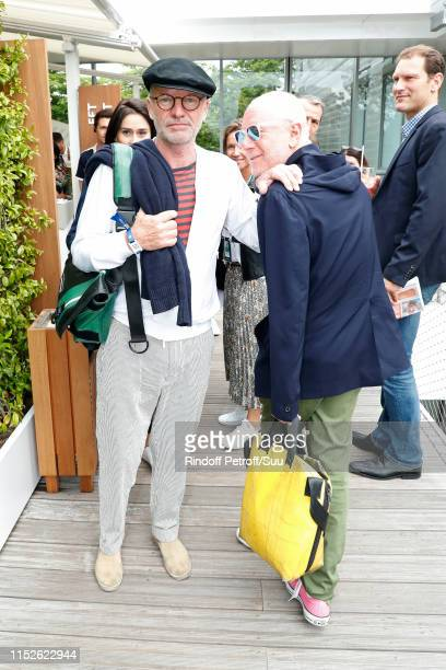 Singer Sting and composer Gaetan Roussel attend the 2019 French Tennis Open - Day Five at Roland Garros on May 30, 2019 in Paris, France.