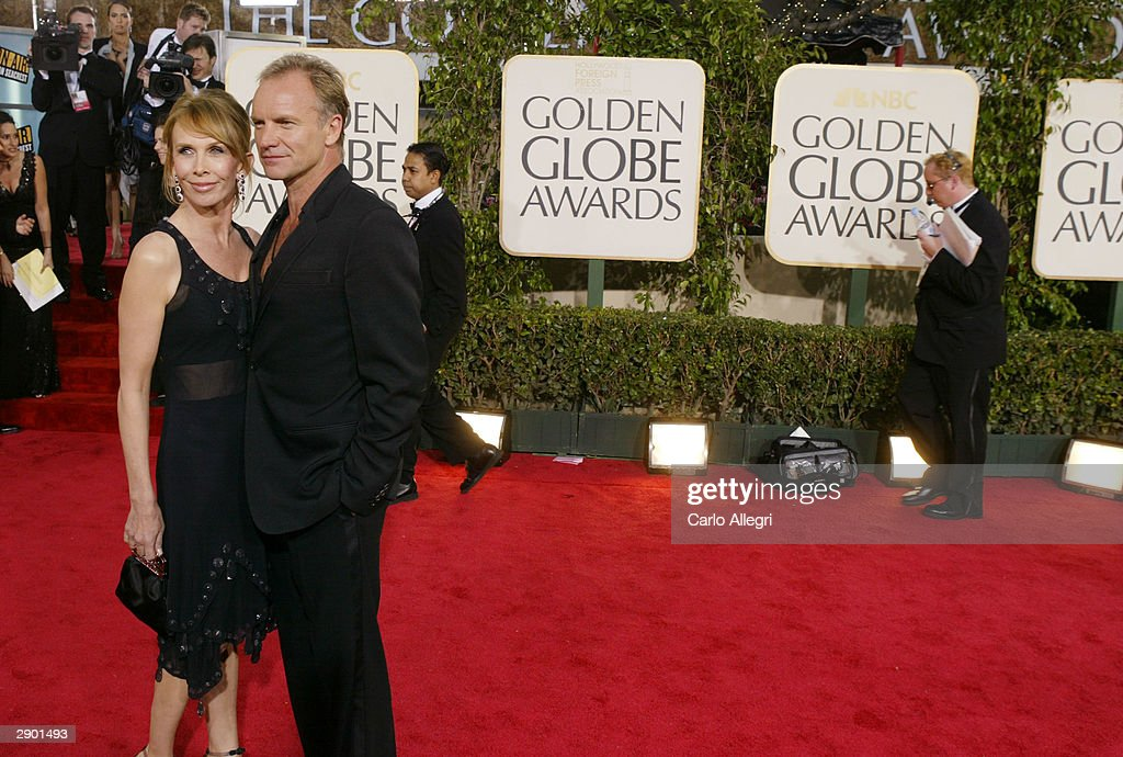 Singer Sting (R) and wife Trudie Styler attend the 61st Annual Golden Globe Awards at the Beverly Hilton Hotel on January 25, 2004 in Beverly Hills, California.