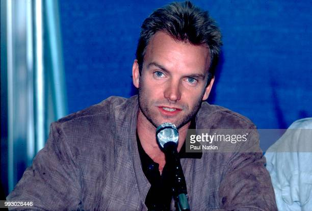 Singer Sting of The Police speaks at a microphone at the Rosemont Horizon in Rosemont, Illinois, June 13, 1986.