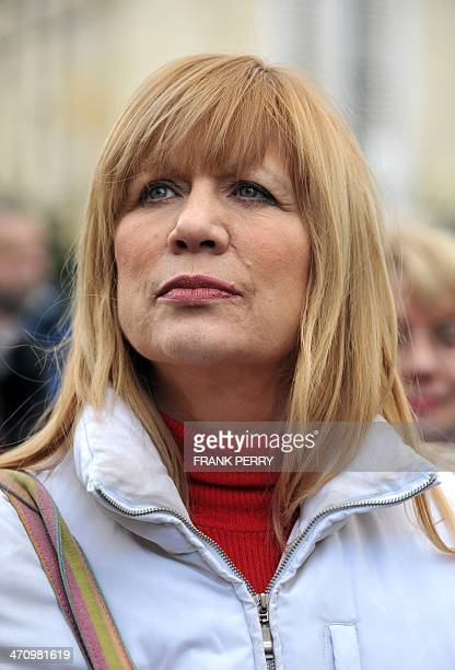 Singer Stone whose real name is Annie Gautrat takes part to a demonstration against the mistreatment of animals on February 21 2014 in Angers western...