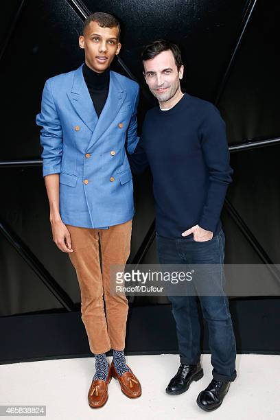 Singer Stromae and Fashion Designer Nicolas Ghesquiere pose after the Louis Vuitton show as part of the Paris Fashion Week Womenswear Fall/Winter...