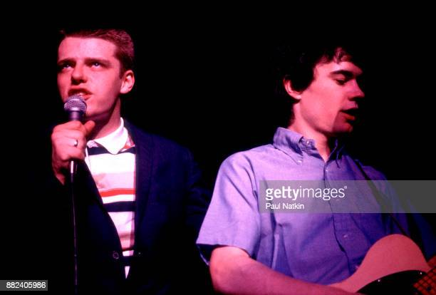 Singer Suggs left and guitarist Chris Foreman of the band Madness perform at the Park West in Chicago Illinois March 1 1980