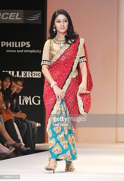 Singer Sunidhi Chauhan displays a creation by Indian designer Shyamal Bhumika on the fourth day of Lakme Fashion Week in Mumbai on September 20 2010