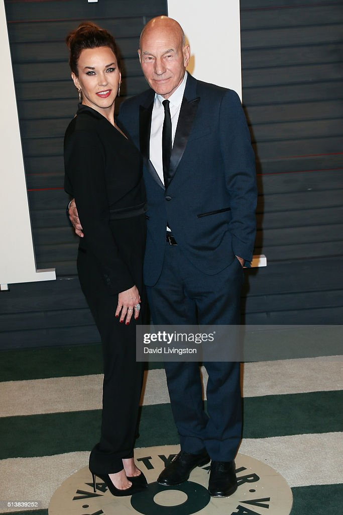Singer Sunny Ozell (L) and actor Patrick Stewart arrive at the 2016 Vanity Fair Oscar Party Hosted by Graydon Carter at the Wallis Annenberg Center for the Performing Arts on February 28, 2016 in Beverly Hills, California.