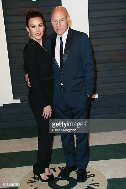 Singer Sunny Ozell and actor Patrick Stewart arrive at the 2016 Vanity Fair Oscar Party Hosted by Graydon Carter at the Wallis Annenberg Center for...