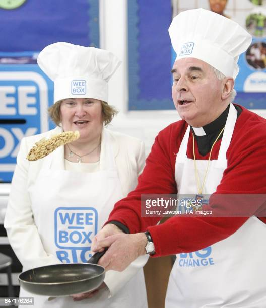 Singer Susan Boyle and Catholic Church leader Cardinal Keith O'Brien flip pancakes at St Augustine's High School in Edinburgh, during the launch of...