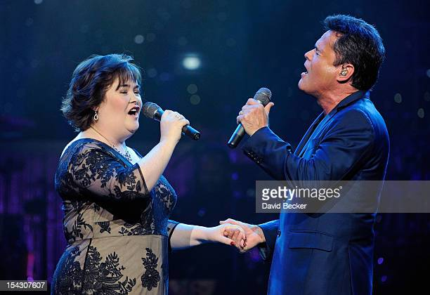 Singer Susan Boyle performs with entertainer Donny Osmond during the Donny Marie variety show at the Flamingo Las Vegas October 17 2012 in Las Vegas...