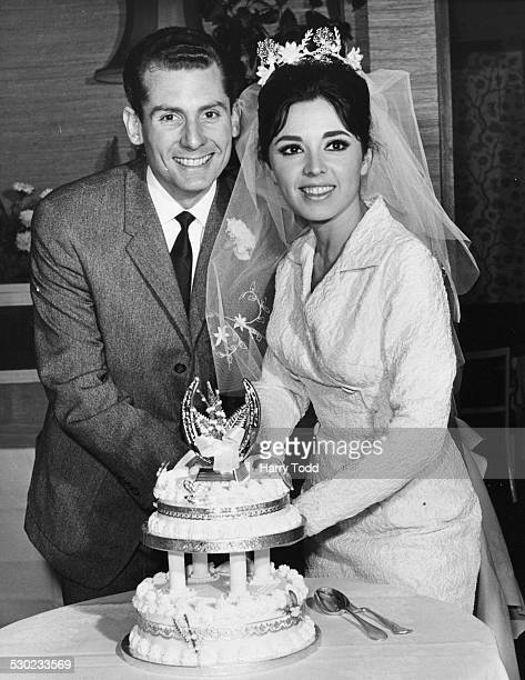 Singer Susan Maughan cutting the cake with her husband Nicholas Teller following their wedding ceremony Berkeley Square London February 8th 1965