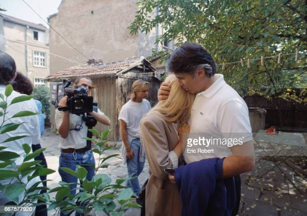 Singer Sylvie Vartan is comforted by her her husband Tony Scotti during a visit to her grandfather's home in Bulgaria