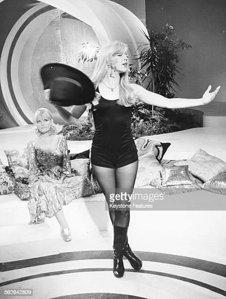 Singer Sylvie Vartan performing as Petula Clark watches during the recording of the television show 'Special Petula' in Paris circa 1968