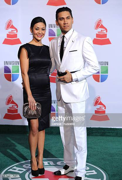 Singer Taboo of the Black Eyed Peas and Jaymie Dizon arrive at the 12th Annual Latin GRAMMY Awards held at the Mandalay Bay Resort Casino on November...