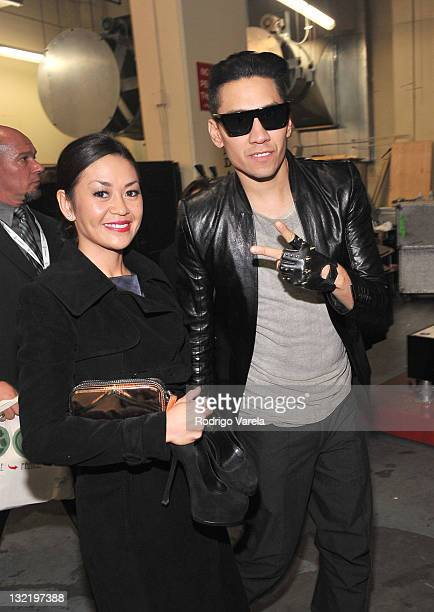 Singer Taboo of the Black Eyed Peas and wife Jaymie Dizon pose backstage during the 12th Annual Latin GRAMMY Awards held at the Mandalay Bay Events...