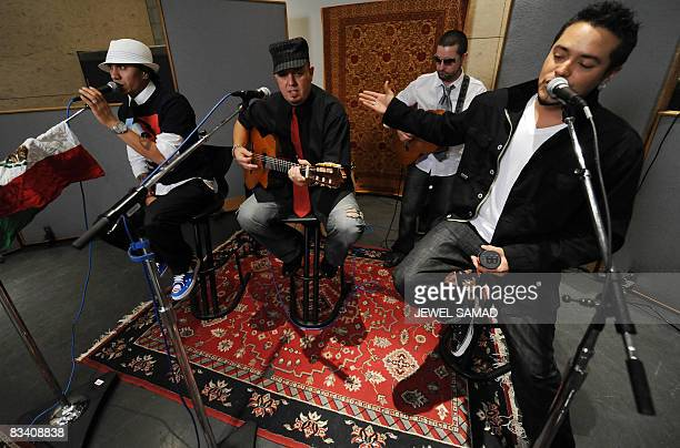 Singer Taboo practices with composer and lead guitarist George Pajon Jounior from Black Eyed Peas and Andy Vargas singer with the band of Carlos...