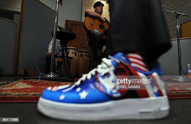 Singer Taboo wearing a shoe featuring a picture US Democratic presidential candidate Illinois Senator Barack Obama arrives with lead guitarist George...