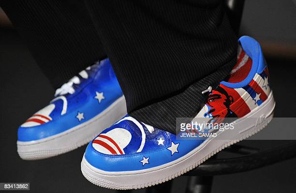 Singer Taboo wearing a shoe featuring a picture US Democratic presidential candidate Illinois Senator Barack Obama practices with lead guitarist...