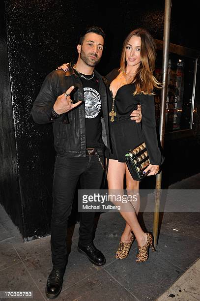 Singer Taki Sassaris of the rock group Eve To Adam and model Courtney Bingham pose in front of The Roxy Theatre on June 11 2013 in West Hollywood...