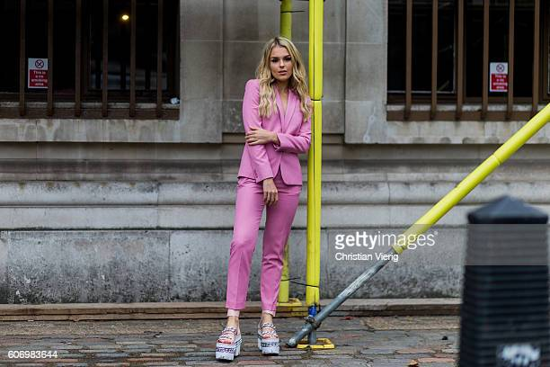 Singer Tallia Storm wearing a pink suit and Louis Vuitton plattform sandals outside of DAKS during London Fashion Week Spring/Summer collections 2017...