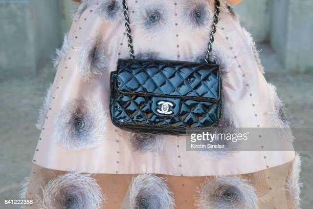 Singer Tallia Storm wears a Chanel dress and bag day 3 of Paris Haute Couture Fashion Week Autumn/Winter 2017 on July 4 2017 in Paris France Tallia...
