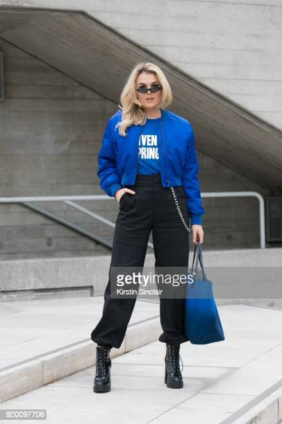 Singer Tallia Storm wears a Givenchy T shirt jacket and bag Zara boots IAMGIA trousers and Poppy Lissiman sunglasses on day 3 of London Womens...