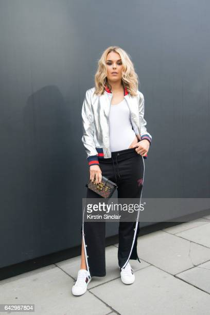Singer Tallia Storm wears a Miss Guided jacket top and trousers Louis Vuitton bag and Gucci trainers on day 1 of London Womens Fashion Week...