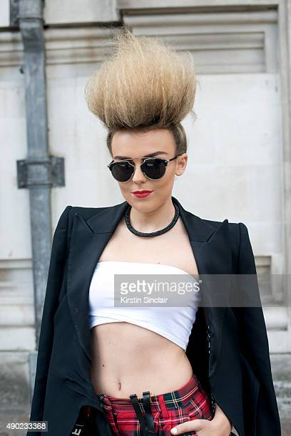 Singer Tallia Storm wears an Armani jacket River Island trousers Chanel braces Topshop top and Dior sunglasses on day 3 during London Fashion Week...