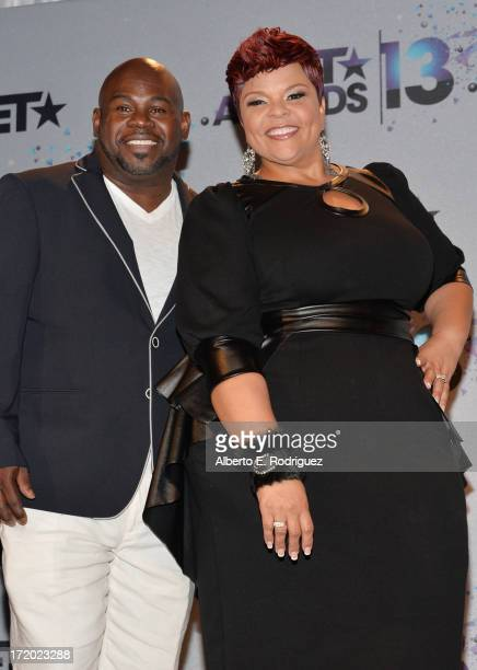 Singer Tamela Mann and David Mann pose in the press room during the 2013 BET Awards at Nokia Theatre LA Live on June 30 2013 in Los Angeles California